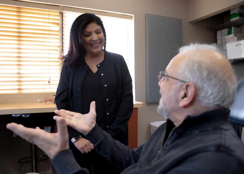 patient speaking with staff members Falls Church, VA