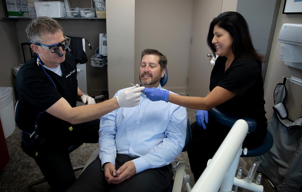 The Northern Virginia Periodontics team during a dental procedure