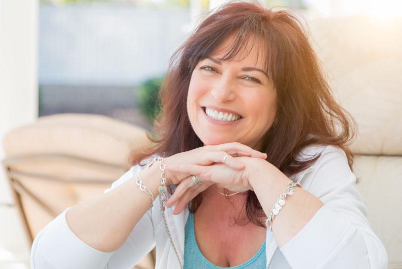 Patient Smiling After Dental Implant Procedures